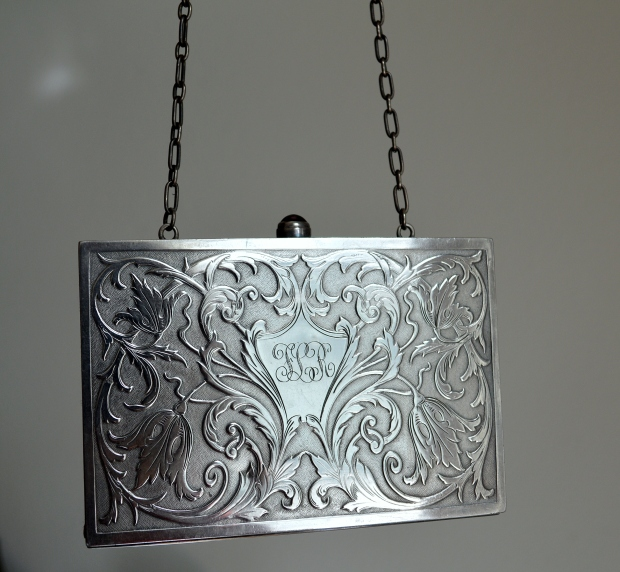 http://www.onlineauction.com/auction/1953424/Victorian-sterling-calling-card--purse.