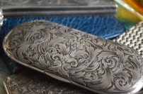 Look at the detail on this silver eyeglass case!